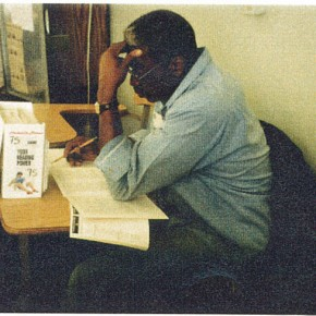 man writing on a peice of paper